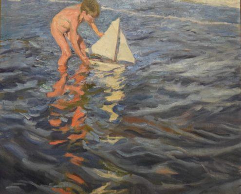 Kind mit Segelschiff